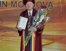 UNIVERSITATEA COOPERATIST-COMERCIALĂ DIN MOLDOVA  A CONFERIT TITLUL DE DOCTOR HONORIS CAUSA  PROF. UNIV., DR.  DUMITRU MARIUS PARASCHIVESCU